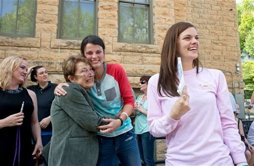 Jennifer Rambo, right, smiles as her partner Kristin Seaton, center, hugs Sheryl Maples, left, the lead attorney who filed the Wright v. the State of Arkansas lawsuit, Saturday, May 10, 2014, in Eureka Springs, Ark.