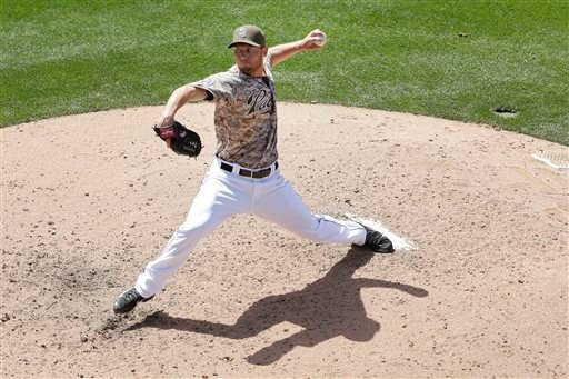 San Diego Padres starting pitcher Robbie Erlin pitches to a Miami Marlins batter during the fourth inning of a baseball game Sunday, May 11, 2014, in San Diego. (AP Photo/Gregory Bull)