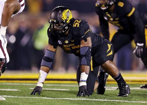 In this Nov. 20, 2013, file photo, Missouri defensive lineman Michael Sam takes up his position during the first half of an NCAA college football game against Texas A&M in Columbia, Mo.