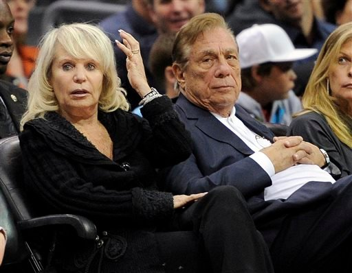 In this Nov. 12, 2010, file photo, Los Angeles Clippers owner Donald T. Sterling, right, sits with his wife Rochelle during the Clippers NBA basketball game against the Detroit Pistons in Los Angeles.