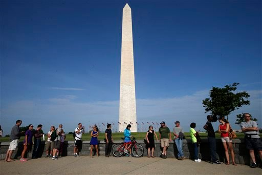 Visitors line up for tickets which are distributed at on a first-come basis at the Washington Monument in Washington, Monday, May 12, 2014, ahead of a ceremony to celebrate its re-opening. (AP)