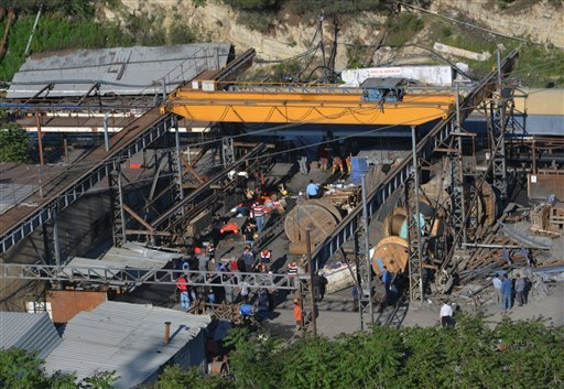 Rescue workers at the entrance of the mine after an explosion and fire at a coal mine in Soma, in western Turkey, Tuesday, May 13, 2014.