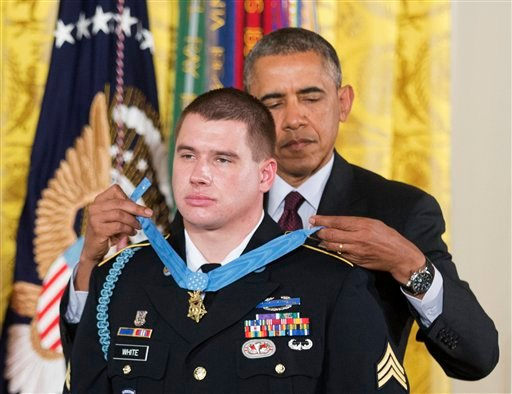 President Barack Obama awards the Medal of Honor to former Army Sgt. Kyle J. White during a ceremony in the East Room of the White House in Washington, Tuesday, May 13, 2014.