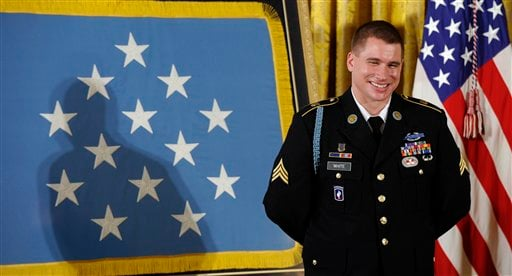 Former Army Sgt. Kyle J. White smiles as President Barack Obama talks about him before he was awarded the Medal of Honor during a ceremony in the East Room of the White House in Washington, Tuesday, May 13, 2014.