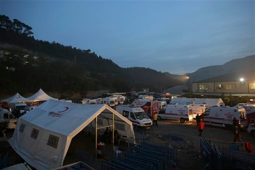 Ambulances wait outside a coal mine in Soma, western Turkey, early Wednesday, May 14, 2014.