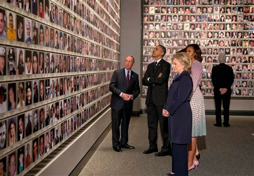 President Barack Obama and first lady Michelle Obama, along with former Secretary of State Hillary Rodham Clinton and former President Bill Clinton tour the Memorial Hall at the National September 11 Memorial Museum.