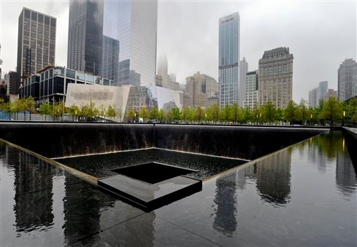 A view of the National September 11 Memorial Museum with the north reflecting pool in foreground during the museum's dedication ceremony in New York on Thursday, May 15, 2014.