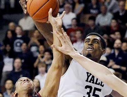 In this March 7, 2014 file photo, Yale's Brandon Sherrod, right, fouls Harvard's Siyani Chambers, left, during the second half of an NCAA college basketball game in New Haven, Conn.
