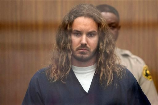 In this May 9, 2013 file photo, Tim Lambesis, 32, front man for the Christian-inspired heavy metal group As I Lay Dying, appears in Vista Superior Court in Vista, Calif.