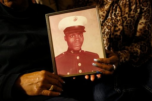 In this March 12, 2014 file photo, a picture of Jerome Murdough is held by his mother Alma Murdough left, and sister Cheryl Warner at Alma Murdough's home in the Queens borough of New York.