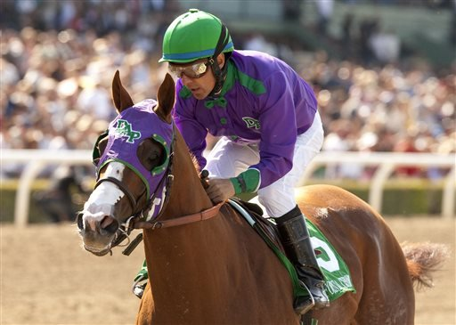 In this April 5, 2014 file photo provided by Benoit Photo, California Chrome and jockey Victor Espinoza win the Santa Anita Derby horse race at Santa Anita in Arcadia, Calif.