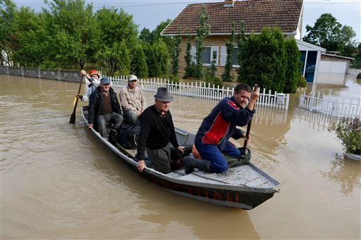 Bosnian people are rescued from their flooded houses by boat in the village of Vidovice near Orasje 200 kms north of Sarajevo, on Sunday May 18, 2014.