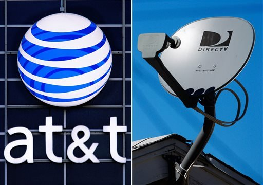 This combo made from file photos shows the AT&T logo on the side of a corporate office in Springfield, Ill., left, and a DirecTV satellite dish atop a home in Los Angeles.