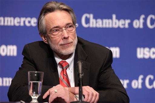 In this Jan. 11, 2011, file photo, Bruce Josten listens during a news conference at the Chamber of Commerce in Washington.
