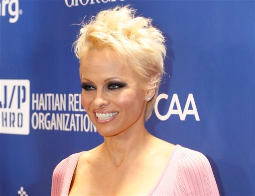 In this Jan. 11, 2014 file photo, Pamela Anderson arrives at the 3rd Annual Sean Penn & Friends Help Haiti Home Gala at the Montage Hotel in Beverly Hills, Calif.