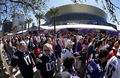 This Feb. 3, 2013 file photo made with a fisheye lens shows fans lined up to enter the Superdome before the NFL Super Bowl XLVII football game between the San Francisco 49ers and the Baltimore Ravens, in New Orleans.
