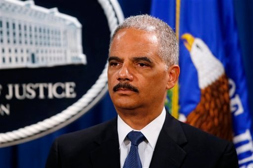 Attorney General Eric Holder listens during a news conference at the Justice Department in Washington, Monday, May 19, 2014.