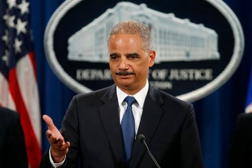 This May 19, 2014 file photo shows Attorney General Eric Holder taking questions during a news conference at the Justice Department in Washington