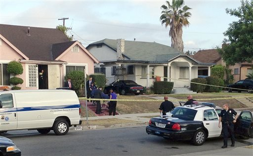 Los Angeles County coroner's officials remove the body of April Jace, the wife of actor Michael Jace, from the couple's home in the Hyde Park area of Los Angeles Tuesday morning, May 20, 2014. (AP)