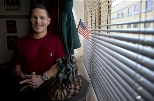 This photo taken May 13, 2014 shows Medically retired Marine Lance Cpl. Kyle Carpenter speaking to media at the Pentagon. (AP)