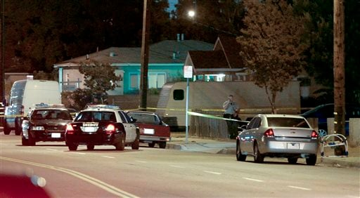 Los Angeles County sheriff's deputies block off the scene of a triple homicide that occurred in the unincorporated area of Los Angeles, Calif. May 20, 2014. (AP Photo/The Daily Breeze, Steve McCrank)
