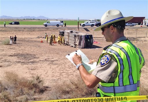 California Highway Patrol officer Kevin Long takes notes at the scene of a fatal accident in Blythe, California on Wednesday, May 21, 2014. (AP)