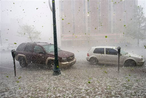 A hail storm hits downtown Colorado Springs, Colo., Wednesday, May 21, 2014. (AP Photo/The Gazette, Christian Murdock)
