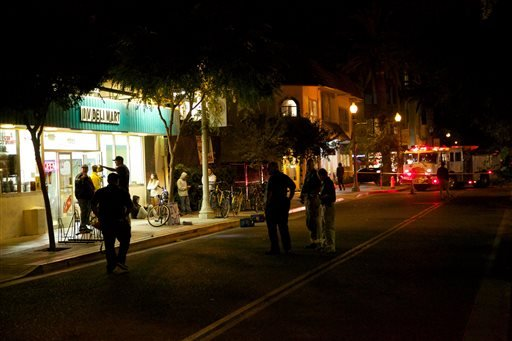 Police investigate after a drive-by shooting that left seven people dead, including the attacker, and others wounded on Friday, May 23, 2014, in Isla Vista, Calif. (AP Photo/The News-Press, Peter Vandenbelt)