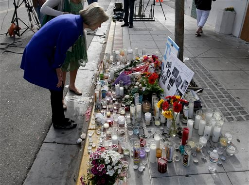 Rep. Lois Capps, D-Santa Barbara, pays her respects at a makeshift memorial in front of the IV Deli Mart, where part of Friday night's mass shooting took place by a drive-by shooter Sunday, May 25, 2014 in the Isla Vista area near Goleta, Calif.