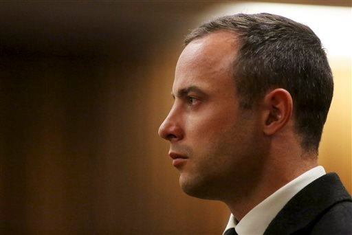 Oscar Pistorius, listens as a court ruling is handed down that he would undergo psychiatric evaluation in Pretoria, South Africa, Tuesday, May 20, 2014.