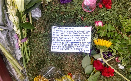 A sidewalk memorial includes a note addressed to Katie Cooper and Veronica Weiss, two of the victims of a shooting rampage by Elliott Rodger, outside the Delta Phi sorority house, in the Isla Vista neighborhood of Goleta, Calif., Monday, May 26, 2014.