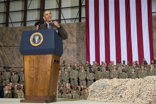 This May 25, 2014 file photo shows President Barack Obama speaking during a troop rally after arriving at Bagram Air Field for an unannounced visit, north of Kabul, Afghanistan. (AP Photo/ Evan Vucci, File)