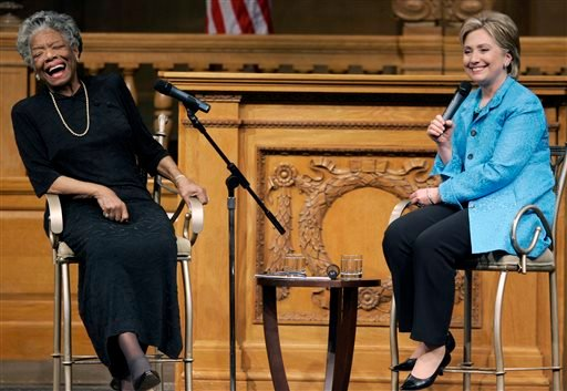 April 18, 2008 file photo, then U.S. Sen. Hillary Rodham Clinton, D-N.Y., right, speaks as poet Maya Angelou reacts during a campaign stop at Wake Forest University in Winston-Salem. (AP Photo/Chuck Burton, File)
