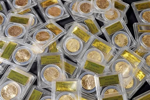 This Feb. 25, 2014 file photo shows some of the 1,427 Gold-Rush era U.S. gold coins displayed at Professional Coin Grading Service in Santa Ana, Calif.