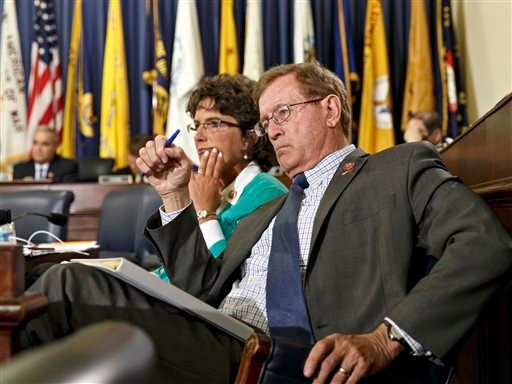 Rep. Paul Cook, R-Calif., right, and Rep. Jackie Walorski, R-Ind., members of the House Committee on Veterans' Affairs listen as officials from the Dpt of Veterans Affairs testify May 28, 2014. (AP Photo/J. Scott Applewhite)