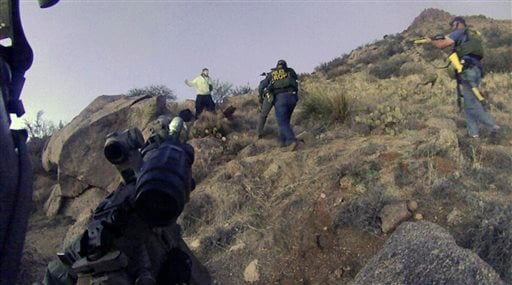 FILE - This March 16, 2014 photo of an Albuquerque Police Department lapel camera still, shows a standoff with James Boyd, before firing six shots at the man. (AP)