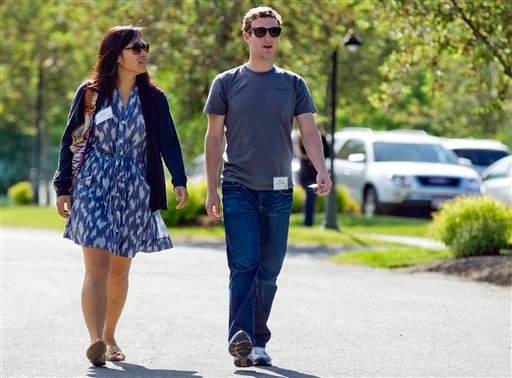In this July 9, 2011, file photo, Mark Zuckerberg, president and CEO of Facebook, walks to morning sessions with his then girlfriend Priscilla Chan during the 2011 Allen and Co. Sun Valley Conference, in Sun Valley, Idaho.