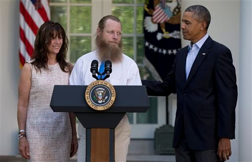 Accompanied by President Barack Obama, Jani Bergdahl and Bob Bergdahl speak during a news conference in the Rose Garden of the White House in Washington May 31, 2014 about the release of their son, U.S. Army Sgt. Bowe Bergdahl. (AP Photo/Carolyn Kaster)