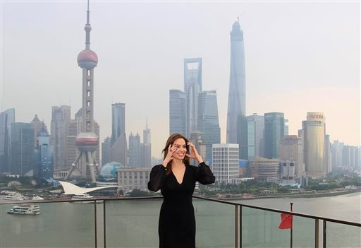 "Actress Angelina Jolie poses for a photo shoot at the Bund as she takes part on a promotion event for her movie ""Maleficent"" in Shanghai, China Tuesday, June 3, 2014. (AP Photo)"