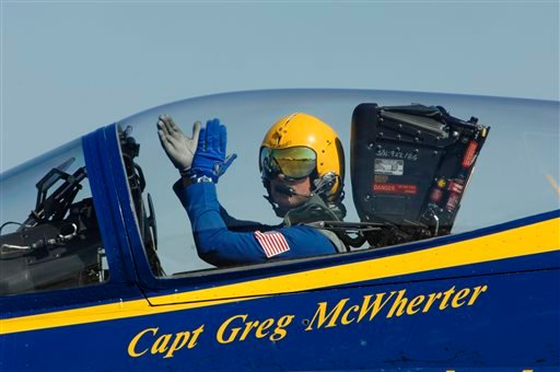 In this Sept. 10, 2011 file photo provided by the U.S. Navy, Capt. Greg McWherter, commanding officer and flight leader of the U.S. Navy flight demonstration squadron, the Blue Angels, responds to the crowd at the Guardians of Freedom Air Show.