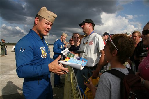 This Oct. 23, 2010 file photo provided by the U.S. Navy, shows Capt. Greg McWherter, left, commanding officer of the U.S. Navy flight demonstration squadron, the Blue Angels, and Lt. Jim Tomaszeski signing autographs.