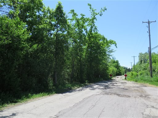 The site in Waukesha, Wis., where a bicyclist found a 12-year-old girl who had 19 stab wounds is seen on Tuesday June 3, 2014.