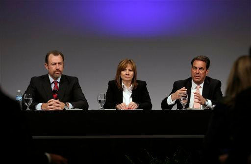 General Motors President Dan Ammann, left, CEO Mary Barra, and Executive Vice President Mark Reuss, hold a press conference at the General Motors Technical Center in Warren, Mich., Thursday, June 5, 2014. (AP)