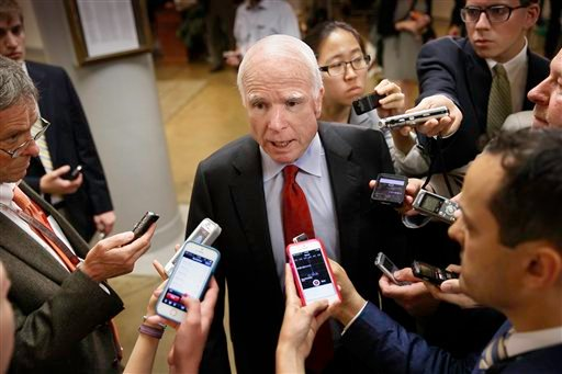 Senate Armed Services Committee member Sen. John McCain, R-Ariz. speaks with reporters on Capitol Hill in Washington, Wednesday, June 4, 2014. (AP)