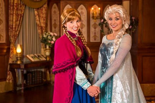 "This undated image released by Disney shows Disney characters Anna, left, and her sister Elsa from the animated film ""Frozen"" at Princess Fairytale Hall at Walt Disney World Resort in Lake Buena Vista, Fla. (AP)"