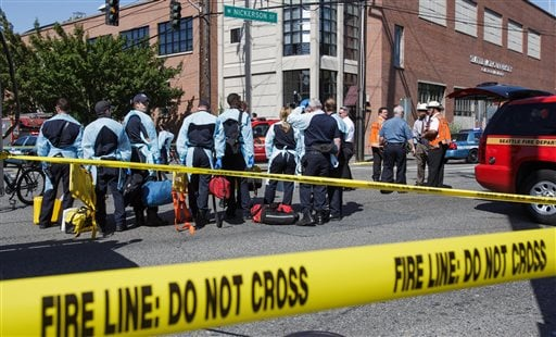 Authorities respond to a shooting at Seattle Pacific University campus Thursday, June 5, 2014, in Seattle.