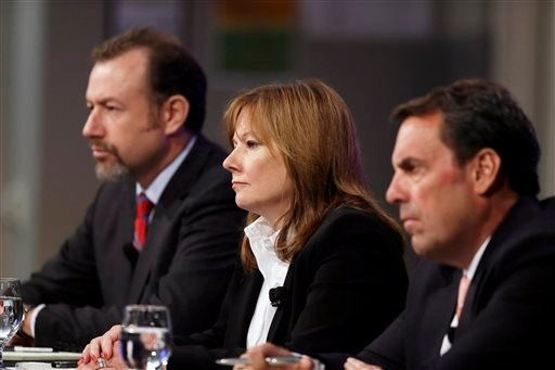 General Motors President Dan Ammann, left, CEO Mary Barra, and Executive Vice President Mark Reuss, hold a news conference at the General Motors Technical Center in Warren, Mich., Thursday, June 5, 2014.