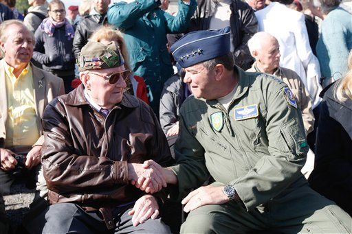 Gen. Philip M. Breedlove Commander, U.S. Air Forces in Europe, right, shakes hands with U.S WW II veteran 90-year-old Curtis Philipps from Georgia, who landed in Picauville on June 6, 1944. (AP Photo/Claude Paris)