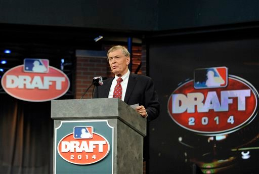 Baseball Commissioner Bud Selig announces the selections during the baseball draft Thursday, June 5, 2014, in Secaucus, N.J.