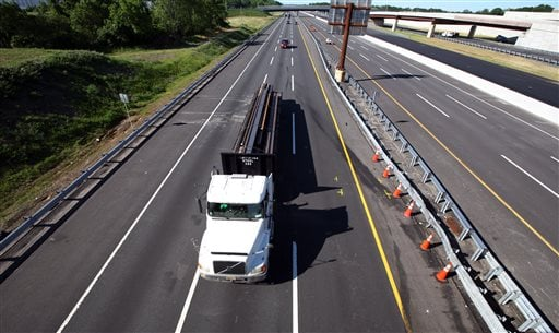 Traffic moves pass the scene of a serious accident at milepost 71 on the northbound lanes of New Jersey Turnpike on Saturday, June 7, 2014 near Cranbury, N.J.